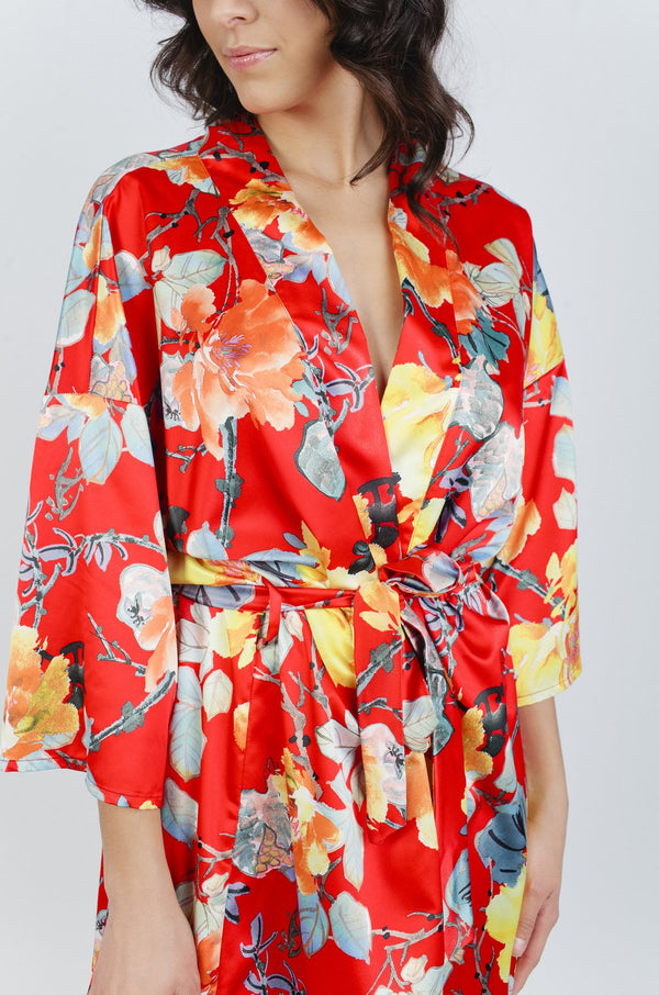 Whether you're getting ready for the big day or settling into your honeymoon, the Red Garden Floral Robe is perfect for all your love moments. This robe was designed on a luxurious silk fabrication that features lace detailing along the edges of the sleeves. Giving your figure a feminine touch with the swingy fit and soft-waist tie, this romantic robe will set the mood wear after wear.