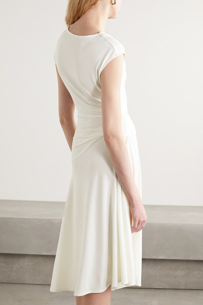 By Malene Birger's 'Aidia' dress is made from off-white stretch-crepe that's lightweight but still provides just enough coverage. It has an elegant cowl neckline and gentle gathering at the waist to create such a flattering drape. The floaty skirt moves beautifully as you walk.