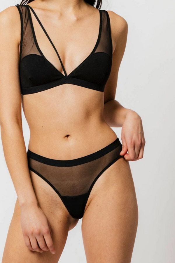 Your classic black staple thong. The emery offers a single layer of mesh and comfortable fit with it sitting a little higher on the hips. Designed by Mary Young in Toronto, Canada.