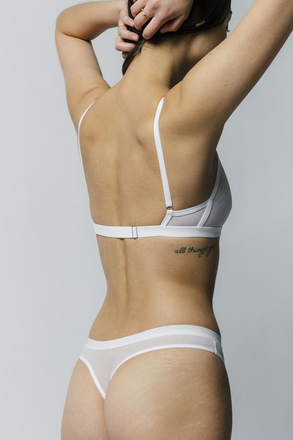 The perfect, classic thong for any outfit. Featuring single layer mesh, the fit is super comfortable sitting higher on the hips. Pair with the Emery Bra for a matching set. Solid white and orange features full rayon of bamboo jersey for ultimate coverage and comfort. Designed by Mary Young in Toronto.