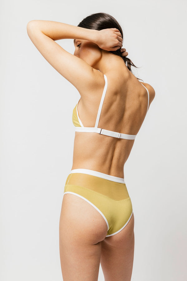 Our Logan Bikini is the perfect cheeky bottom with contrasting mesh paneling and a brazilian cut. Our super soft bamboo jersey and mesh will make you reconsider high rise. Designed to sit comfortably at your natural waist; this style is perfect for all day comfort. Designed by Mary Young in Toronto.