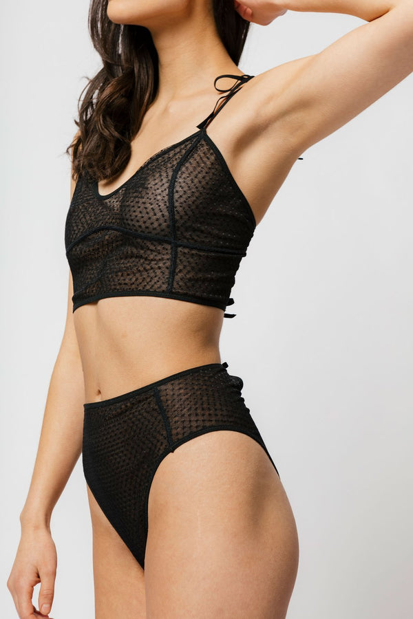 The Myah Bra features double layer dotted mesh for a playful look and super soft feel. This long line cut offers versatility and more support. With soft tie strap shoulders and a back cutout with ties you can tighten or loosen based on your shape. We recommend pairing the Myah over a fitted top for the ultimate inner wear as outwear look!\