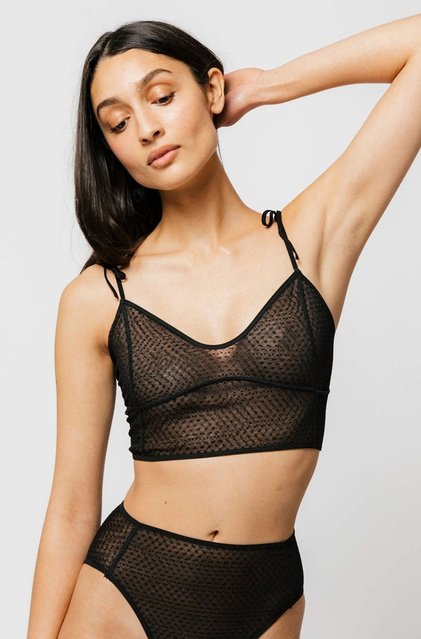 The Myah Bra features double layer dotted mesh for a playful look and super soft feel. This long line cut offers versatility and more support. With soft tie strap shoulders and a back cutout with ties you can tighten or loosen based on your shape. We recommend pairing the Myah over a fitted top for the ultimate inner wear as outwear look!
