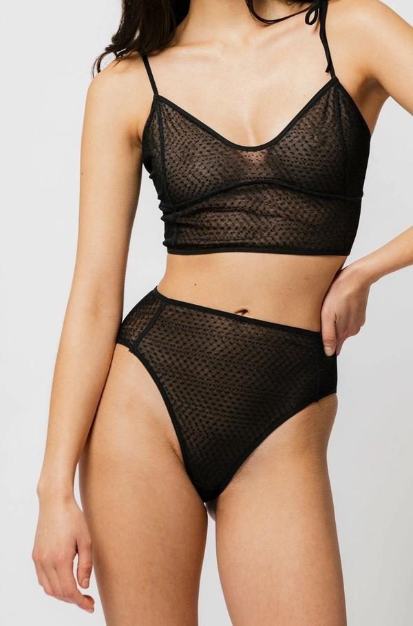 The Myah High Brief offers double layer dot mesh with just the right amount of coverage. Designed to sit at your natural waist with a high leg opening, these panties are a must. With a cut out in the back, mirroring the Myah Bra, the soft ties allow you to tighten or loosen for your comfort. Made in Canada by Mary Young.