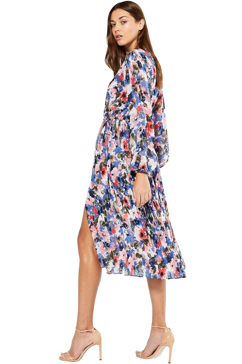 Sophisticated and feminine, the Juliana Tie Dye Dress designed by MISA is a vibrant midi trans-seasonal dress that is perfect for an office to polished evening look. Cut from delicate floral printed chiffon, the long sleeves with elastic finish and pleated skirt elevate this midi silhouette, while a slit up the left left gives it a playful element. Back button closure with piping.