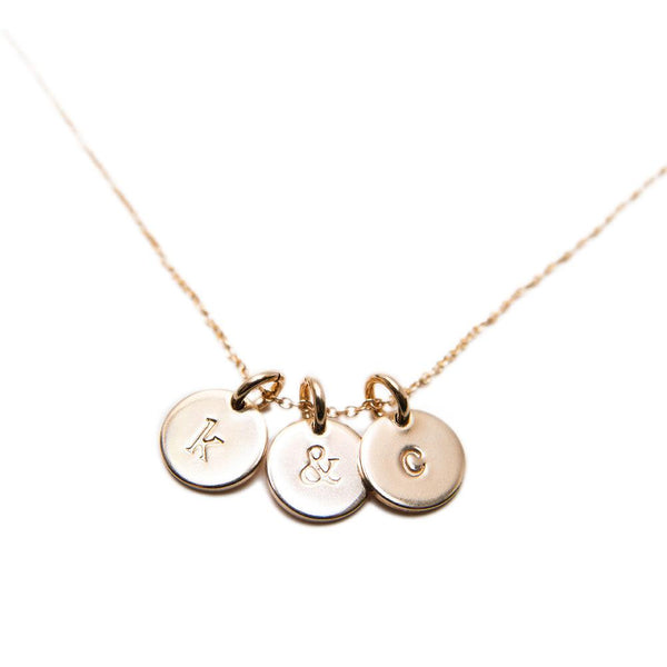 "Made with 14K gold fill, hand stamped charms are our all-time-favourite gift for your bridesmaids, best friend, mom, sister, WHOEVER! The cutest way to wear something personal! Layer it up with additional initial gold charms, 14k gold chain also available online. Letters ""A-Z"" and ""&"" ampersand are available. If a letter is out of stock, we will gladly order it for you!"