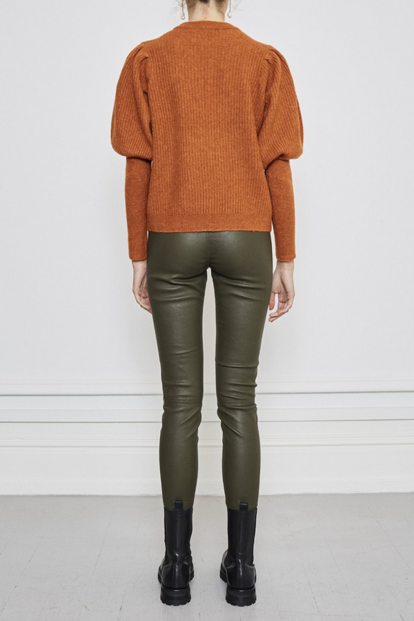 The perfect knit with a flare. Spice up your sweater life and cozy up with Notes Du Nord Rhona Blouse. Featuring a knit design in an earthy burnt orange tone. Made from a super soft wool and alpaca blend.