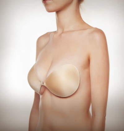 A staple at LoversLand and the perfect bra for all dresses and tops that require no straps and a little extra cleavage. The Adhesive Seamless Nubra features a lightweight fabric with seamless edges, made with skin-friendly and reusable adhesive that easily sticks onto the skin without losing grip. The front closure help to provide cleavage control. Made in USA.