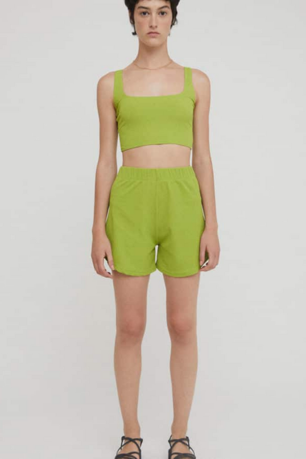 The Nika Top is a bright olive knit bustier that pairs with absolutely everything. Style as a bustier, bralette or crop top - we love this look with a classic biker short or high-waisted pair of jeans. This garment has been produced by responsible manufacturing partners and designed by Rita Row. Made from a recycled plastic polyamide blend.