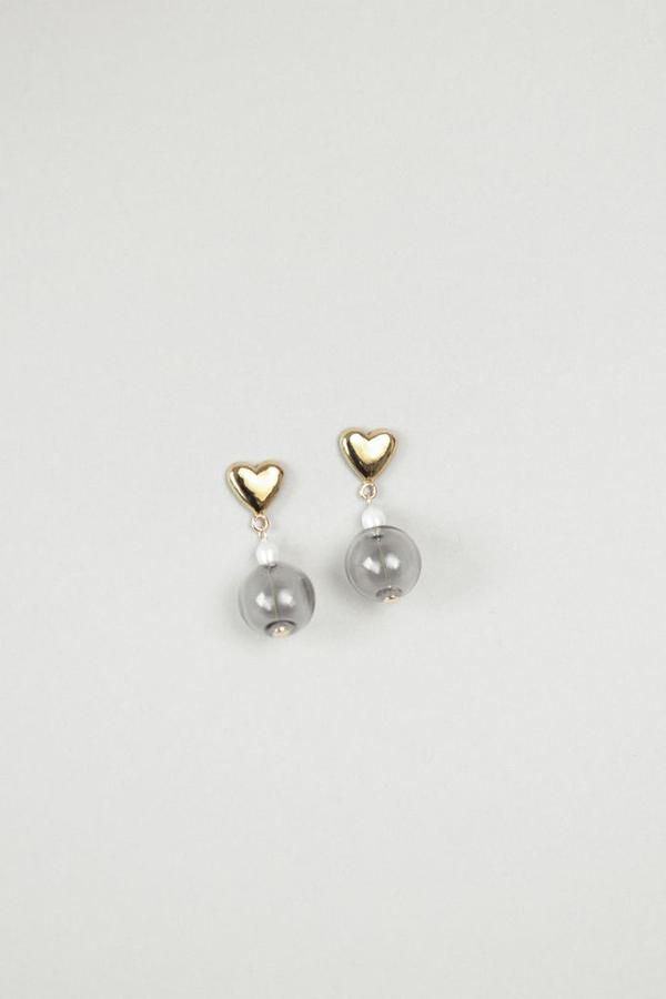 The most elegant drop pearl and glass earrings designed by Wolf Circus. Featuring a 14k gold plated bronze heart stud earrings with a freshwater drop pearl and smoky stacked glass bead. All metals are made from recycled materials, making the Frankie Gold Earrings our favourite eco-friendly option.