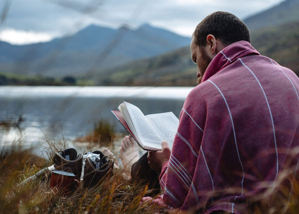 Reading after a mountain tarn swim