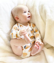Newborn baby burrito onesie orange fish print. Made from organic cotton. Fits snuggly and comfortably. Non-irritating.