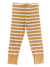 Brown and white striped PJ's. Pajamas for toddlers and babies made from organic cotton. This bundle + lotion combination will ensure that your child's skin is soft and non-irritated
