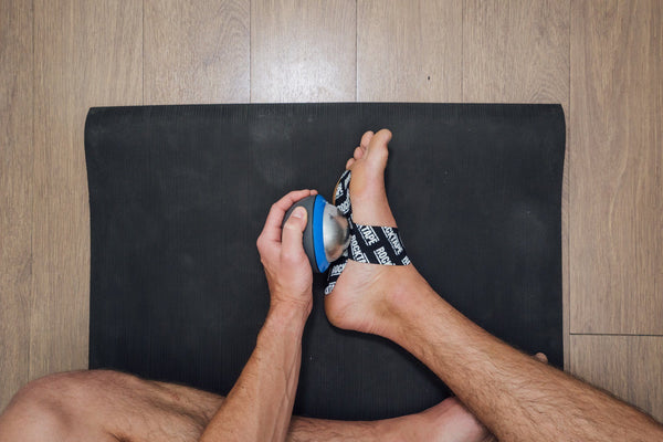 How To Fix Plantar Fasciitis Using KT Tape and Ice Massage