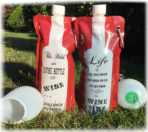 Two portable wine bags and cups outside on grass