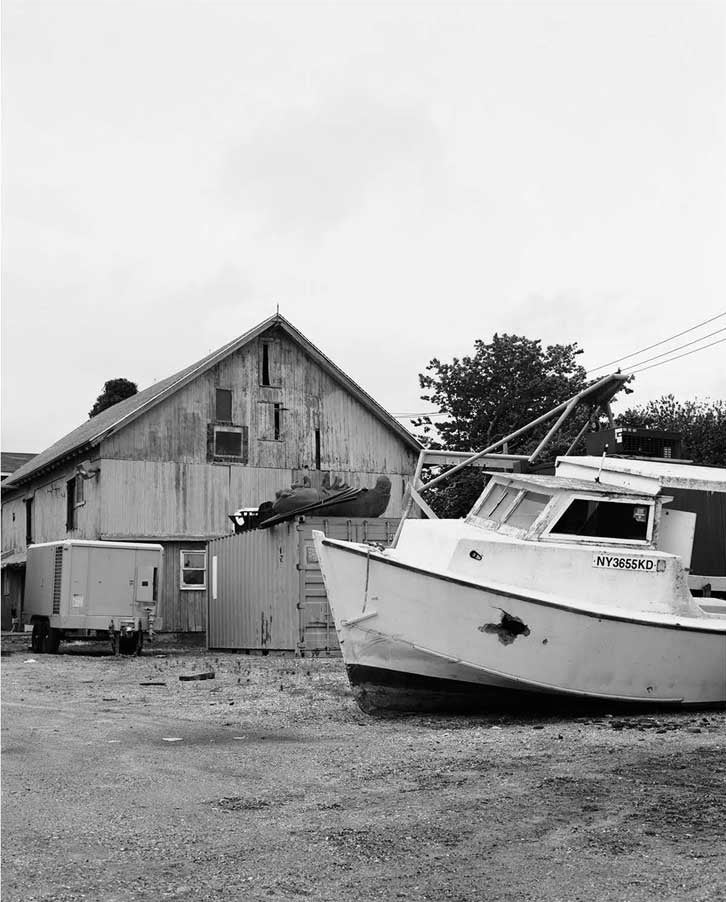 Boat in front of a wooden building