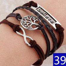 Chrismas Promotion Discount Retro Punk Bradided Wax Cords Infinity Love cross Anchor Owl Hungry Games Charms bracelets