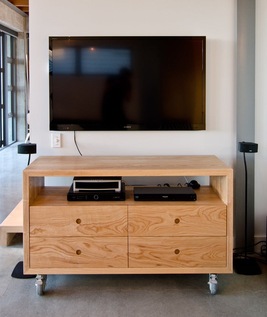 Solid Ash TV cabinet with drawers on lockable castors