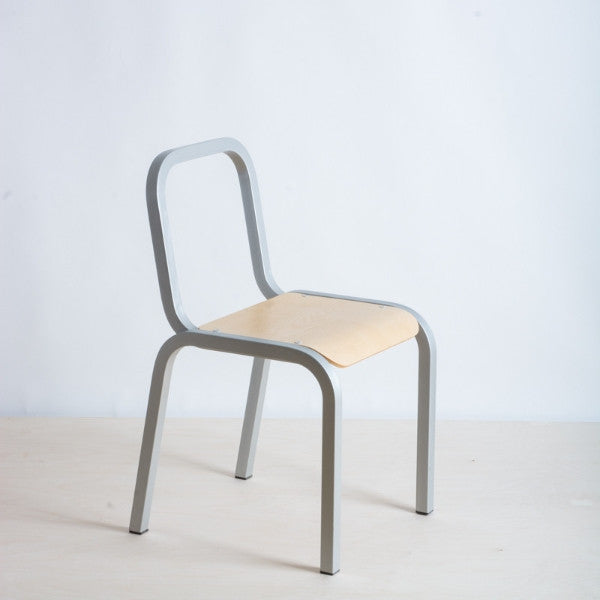 Cafe dining chair made with recycled aluminium with an Ash veneered plywood base