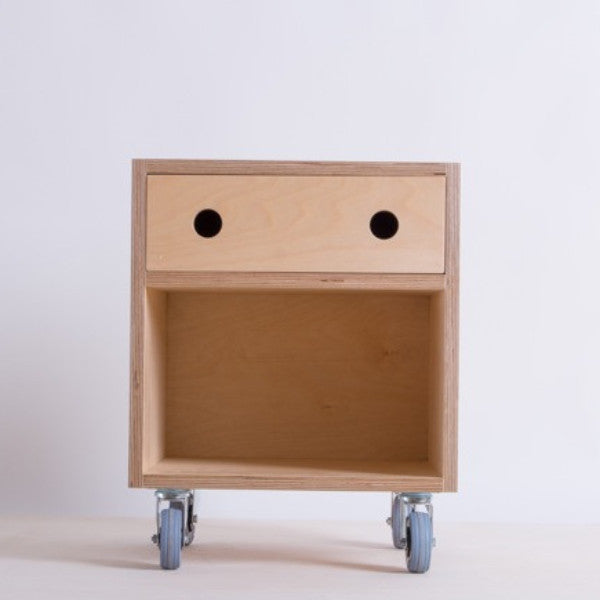 Plywood bedside cabinet with soft close drawer on lockable castors hand finished in Osmo oil