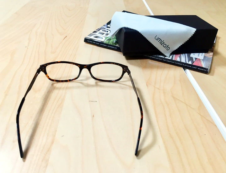 Tortoise prescription glasses began from Umizato sitting on a flat surface