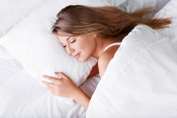 women in bed sleeping