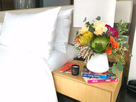 bedside table flowers in vase