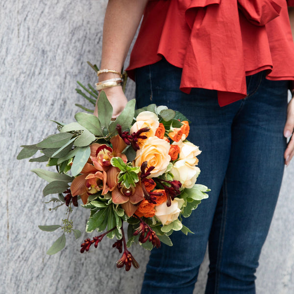 The Auburn | Orange Rose flowers being held | BYDEAU