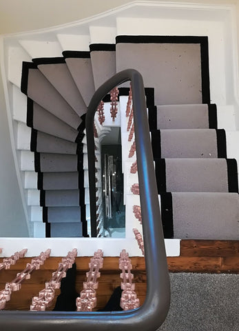Brintons Carpets Bell Twist Pumice/Ebony Stair Runner fitted on concrete stairs.