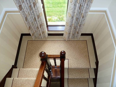 Fully fitted stair carpet design using Brintons Carpets Laura Ashley Woodville Farmhouse 176/29811 with a 1/2 inch insert line of Bell Twist Truffle 15882 and Bell Twist Sandstorm 22682 to the outer edge