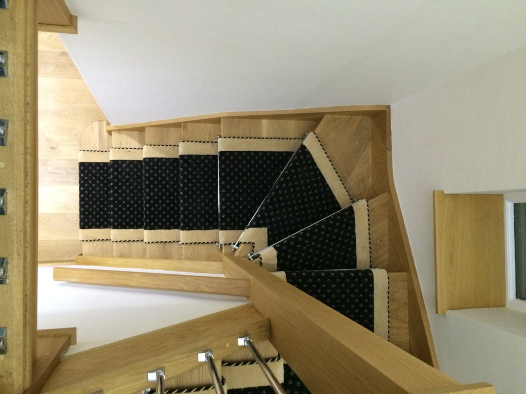 installing carpet on winding stairs