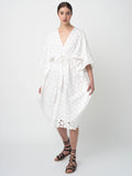 Leila Ligougne all over white daisy embroidery on white cover-up.