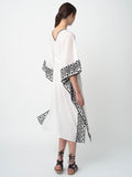 Leila Ligougne white cover-up with black embroidery.