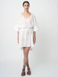 Leila Ligougne white oversize dress with white embroidery.