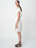 Leila Ligougne white pop over dress with lace insets and ruffles.