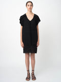 Leila Ligougne black pop over dress with lace insets and ruffles.