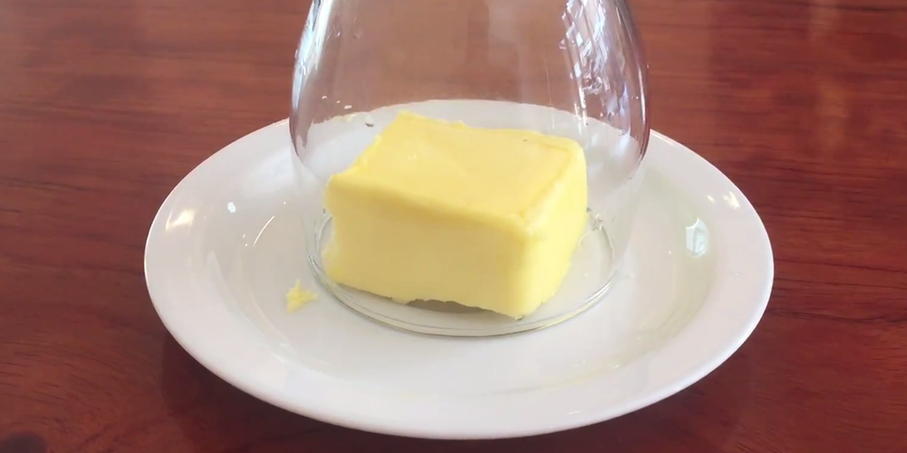 Butter being softened by a warm wine glass.