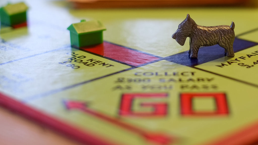Monopoly board with dog and houses