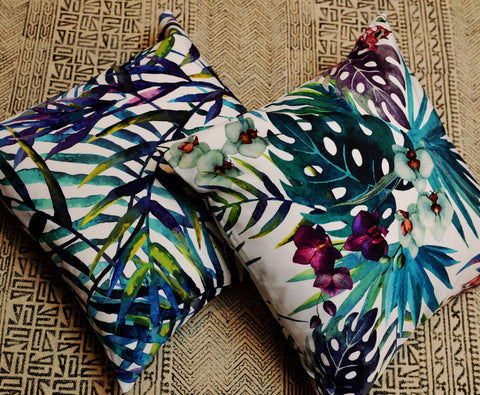 cushions with tropical leaves and flowers print
