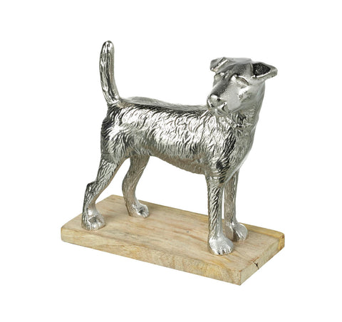 Silver dog on pale wood stand