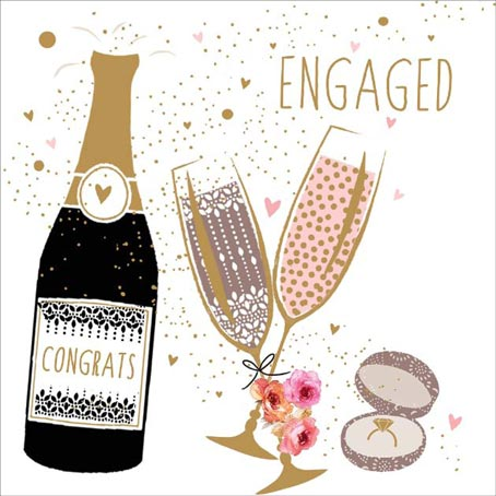 engagement cards with ring and champagen glasses