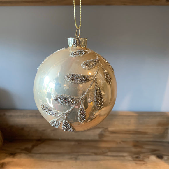 champagne pearl oyster christmas tree bauble decoration with a sparkly leaf pattern