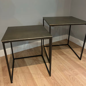 set of two nesting tables in an industrial inspired design in gold and black