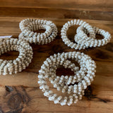 set of four faux pearl beaded napkin rings