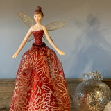 Red and gold fairy decoration for the top of the christmas tree