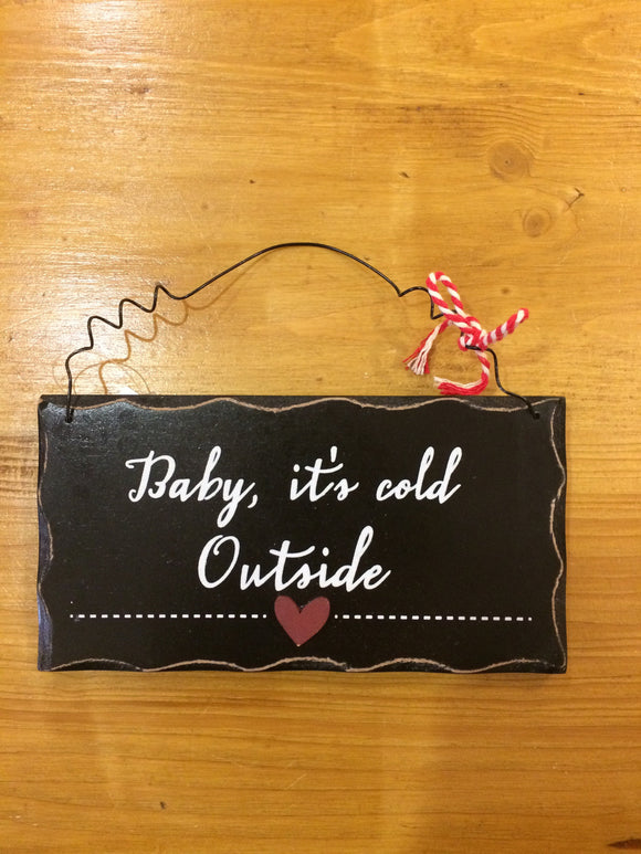 hanging plaque with wire hanger and the text baby it's cold outside