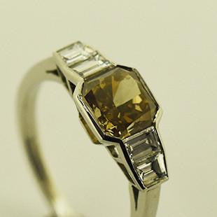 yellow coloured gemstone with tapered shoulders