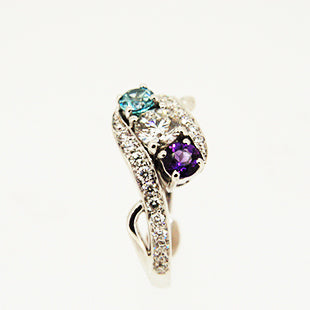 diamond, amethyst and blue zircon three stone engagement ring