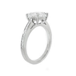 Channel set diamond engagement ring with princess cut diamond