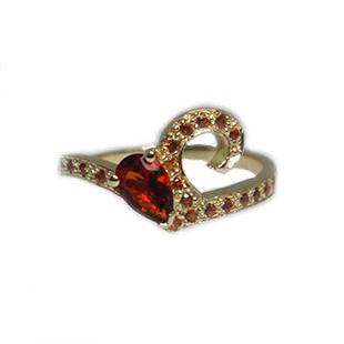 yellow gold ring wiht red stones on band and ruby statement stone